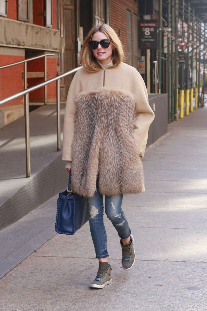 Olivia Palermo in fur coat and ripped Jeans in New York City