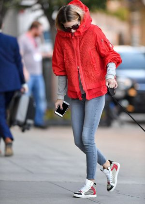 Olivia Palermo in orange jacket walking Mr. Butler in Brooklyn