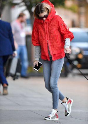 Olivia Palermo in orange jacket walking Mr. Butler in Brooklyn