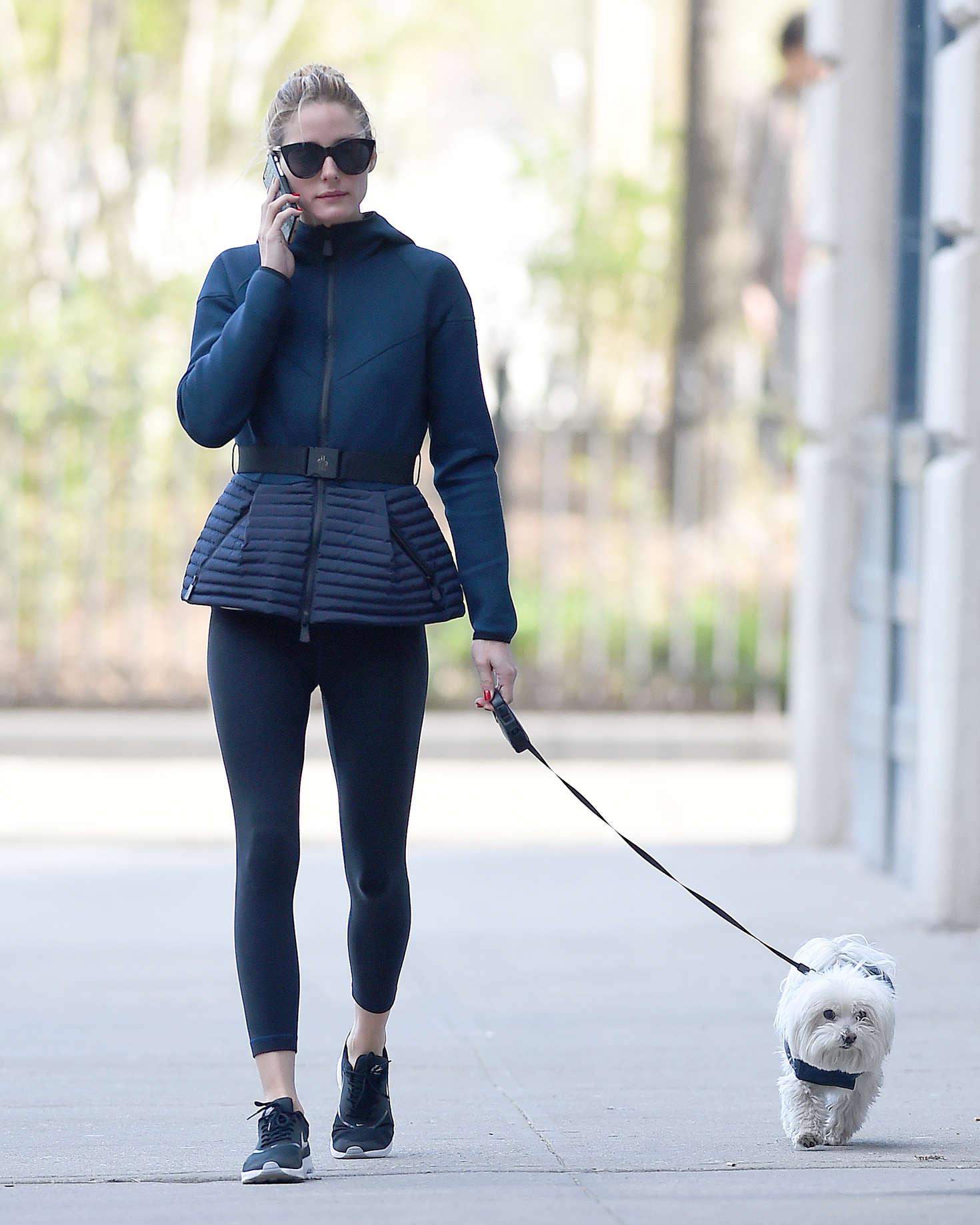 Olivia Palermo in tights walking her dog in Brooklyn