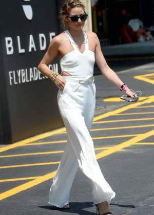 Olivia Palermo in White Jumsuit out in NYC