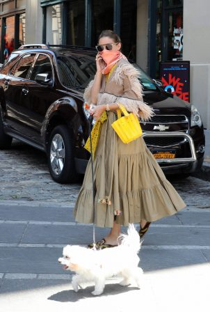 Olivia Palermo - Taking her dog Mr Butler out for a walk in Brooklyn
