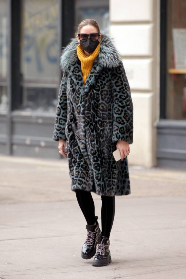Olivia Palermo - Wearing a Cara Mila blue leopard print coat and Moncler ski boots in New York