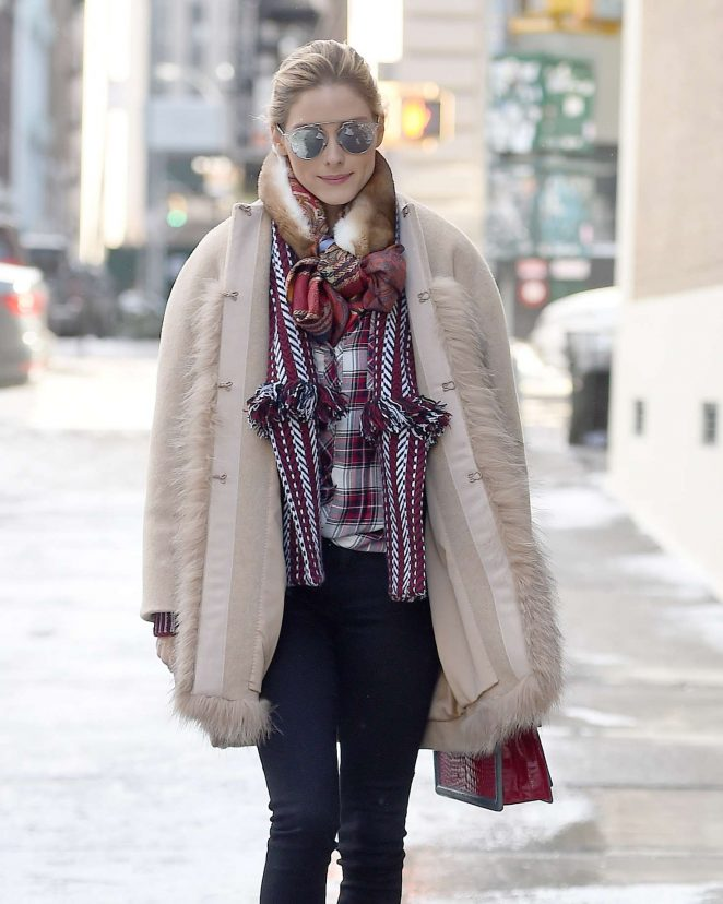 Olivia Palermo wearing a fur coat while walking in the snow in NY