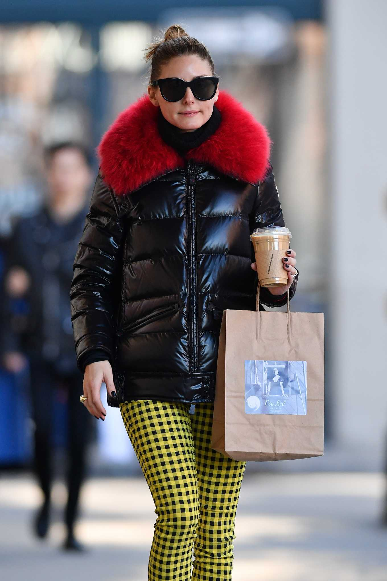 Olivia Palermo - Wearing yellow patterned pants with a black jacket with red fur in Brooklyn