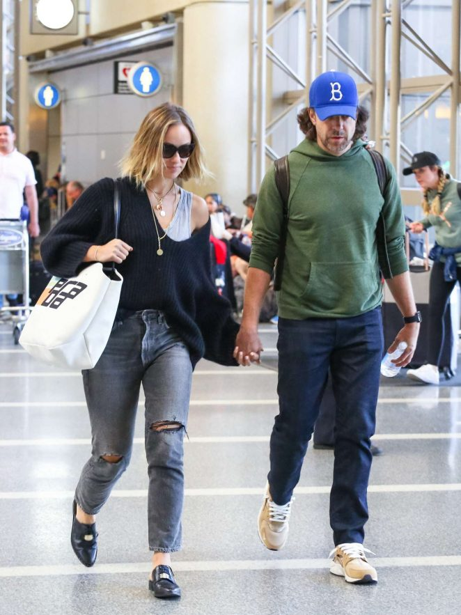 Olivia Wilde and Jason Sudeikis - Arriving at LAX Airport in Los Angeles