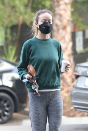 Olivia Wilde - In a green sweater top and grey leggings out in Los Feliz