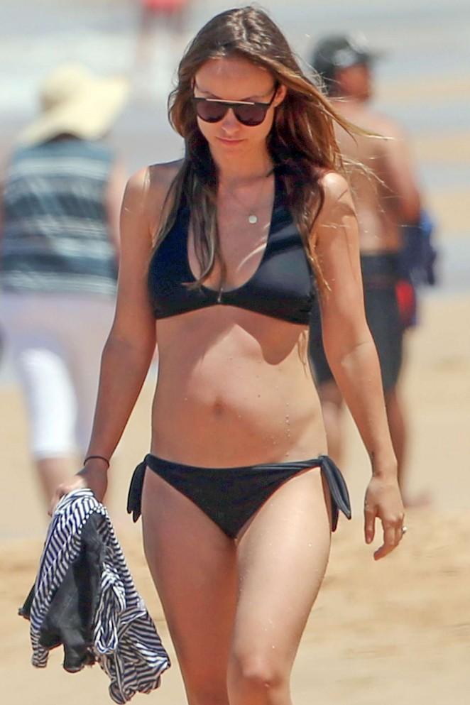 Olivia Wilde in Black Bikini at a beach in Hawaii