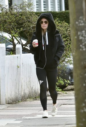 Olivia Wilde - In tights grabbing a coffee in London