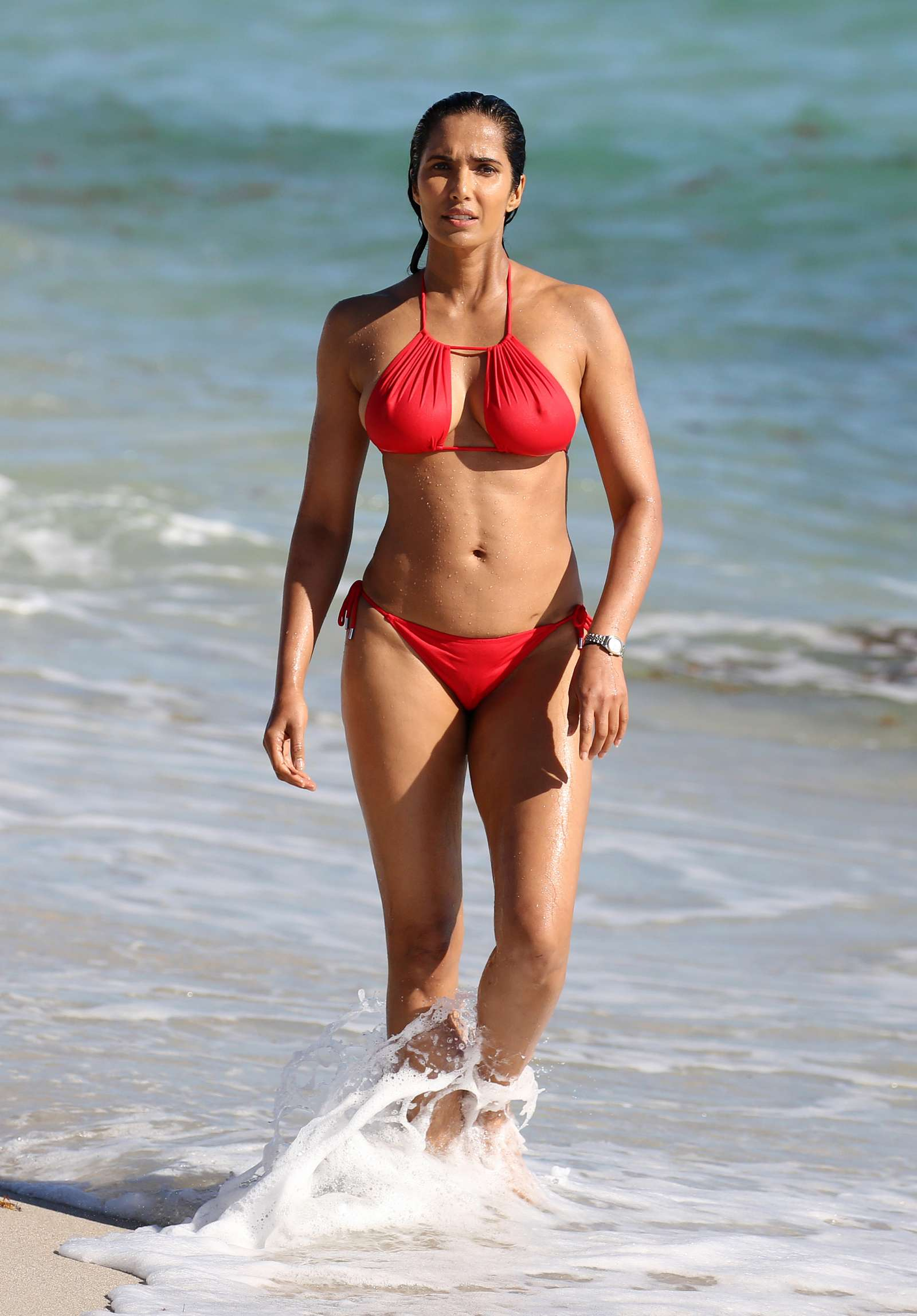 Padma Lakshmi in Red Bikini at the beach in Miami