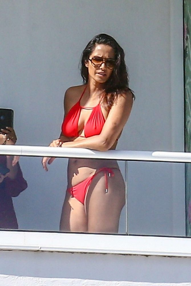 Padma Lakshmi in Red Bikini on her hotel balcony in Miami