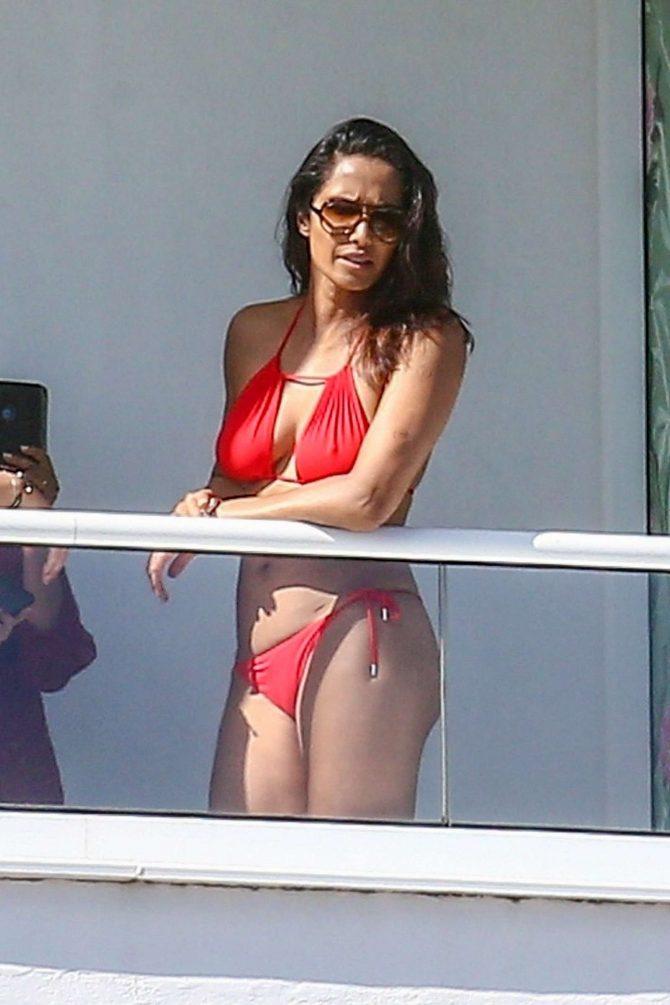 Padma Lakshmi in Red Bikini on her hotel balcony in Miami