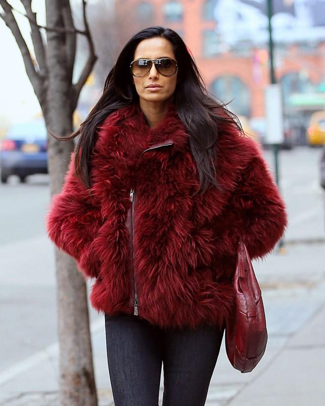Padma Lakshmi in red fur coat out in NYC
