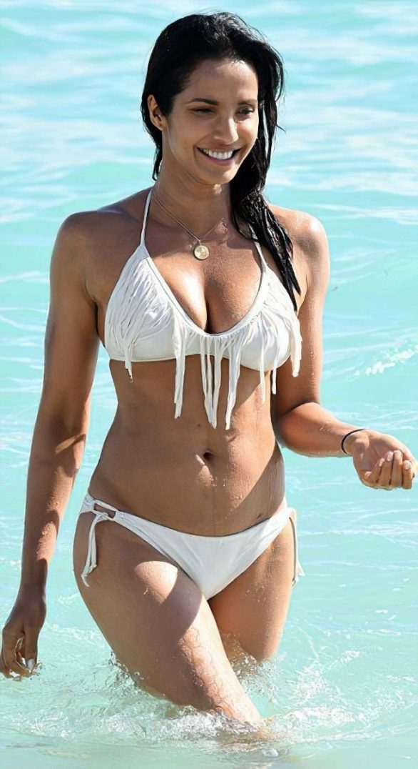 Padma Lakshmi in White Bikini on the beach in Miami