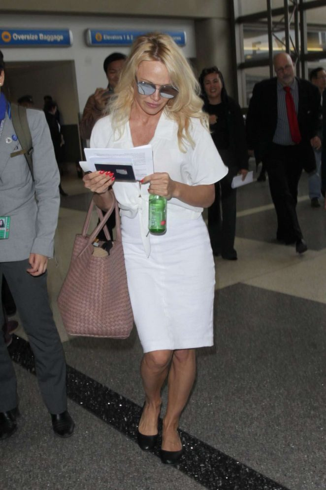 Pamela Anderson - Arrives at LAX Airport in Los Angeles