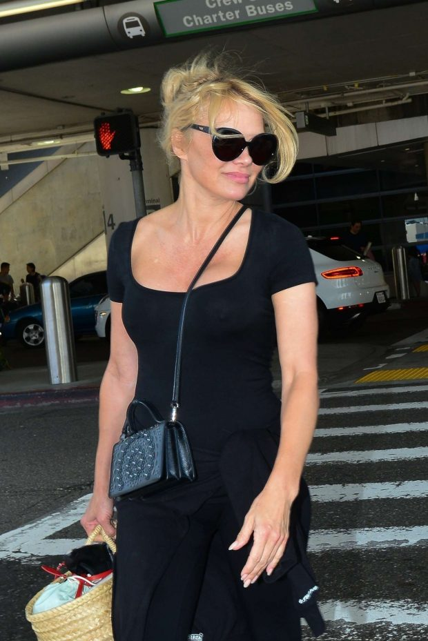 Pamela Anderson - Arrives at LAX International Airport in LA