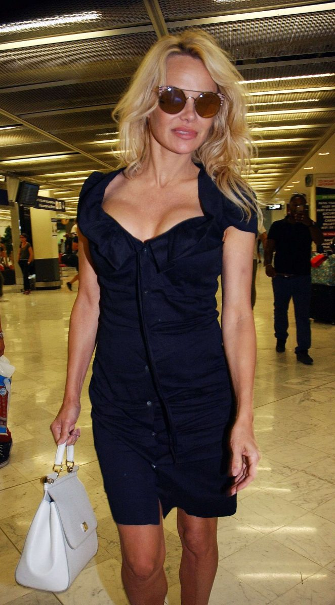 Pamela Anderson - Arriving at Orly Airport in Paris