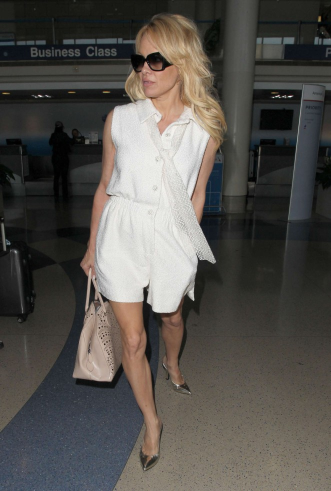 Pamela Anderson in White Dress at LAX Airport in LA