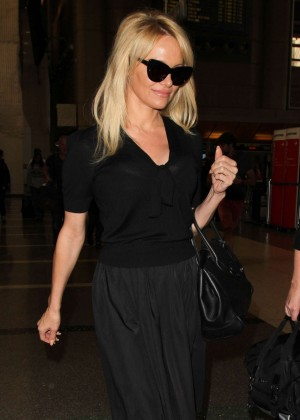 Pamela Anderson in Black Dress at LAX in LA
