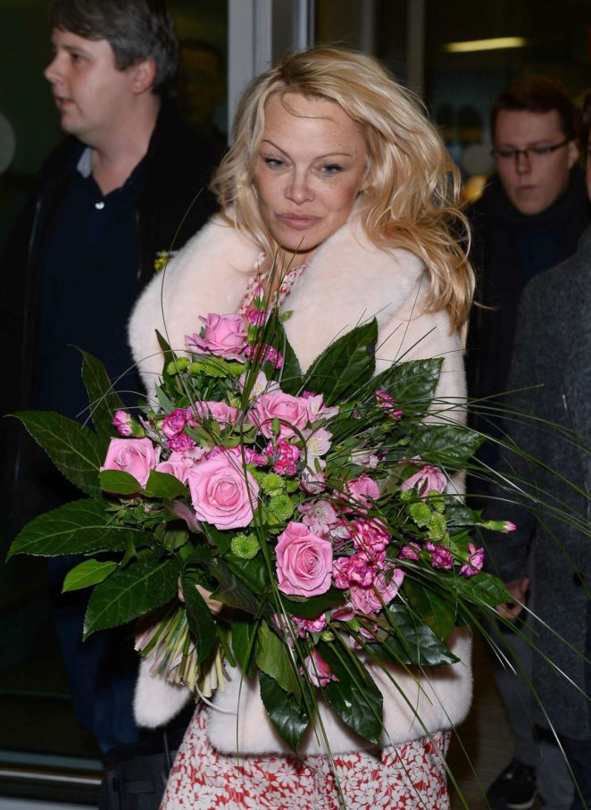 Pamela Anderson at the airport in Warsaw