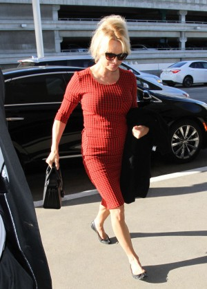 Pamela Anderson in Red Dress at LAX Airport in Los Angeles