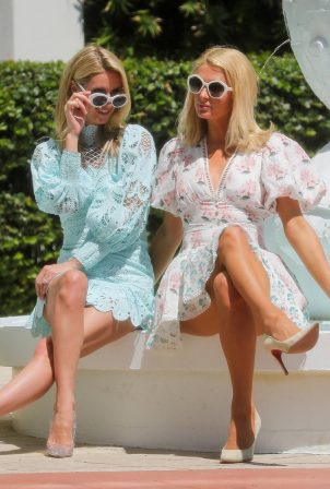 Paris and Nicky Hilton - Posing for pictures at W Hotel in Miami Beach