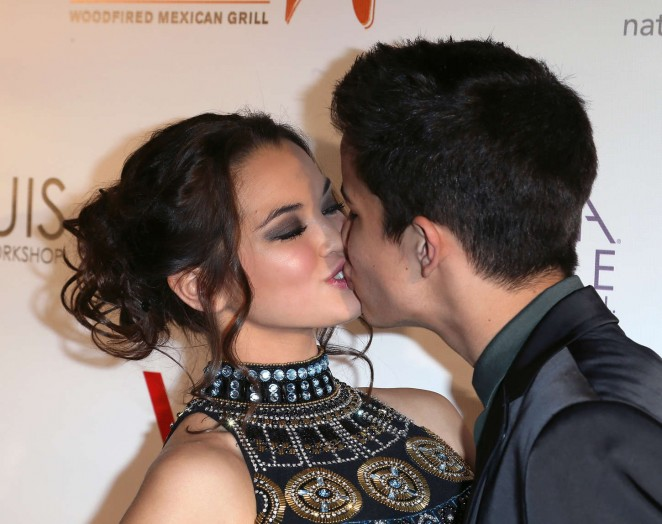 Aramis Knight kissing his girlfriend Paris Berelc