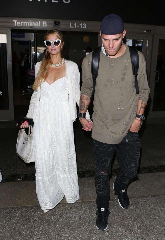 Paris Hilton and Chris Zylka at LAX Airport in LA