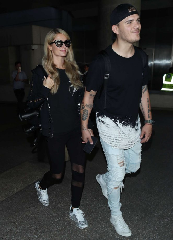 Paris Hilton and Fiance Chris Zylka at LAX airport in LA