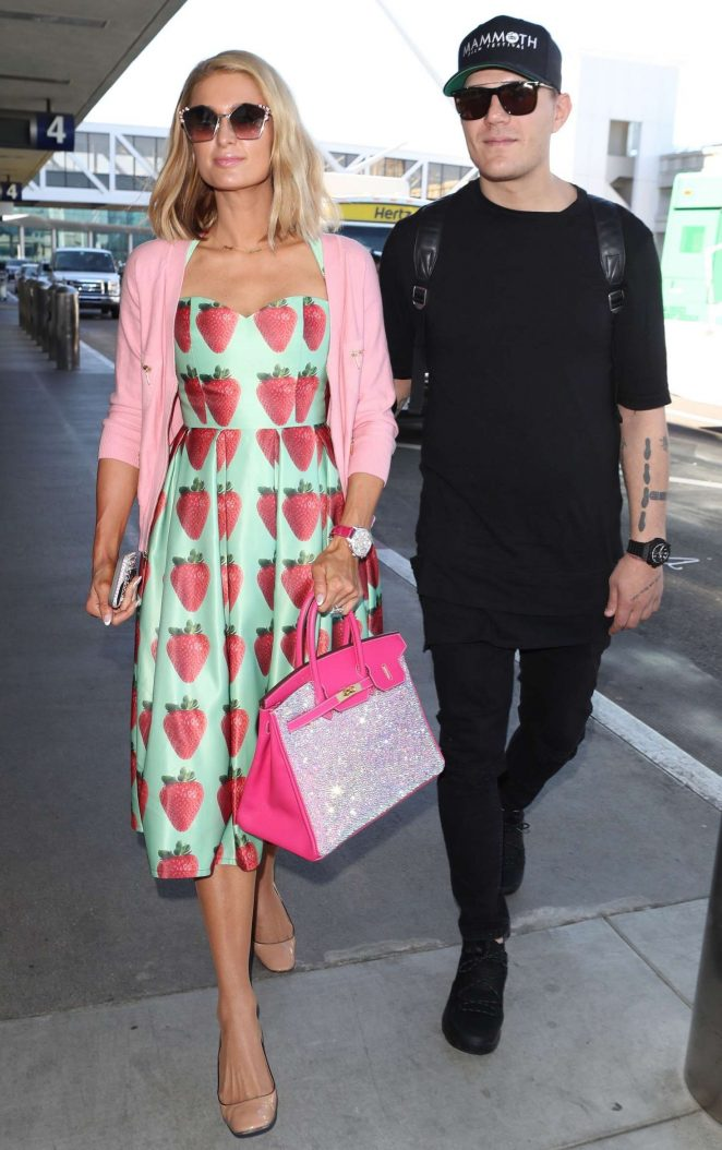 Paris Hilton and fiance Chris Zylka at LAX airport in Los Angeles