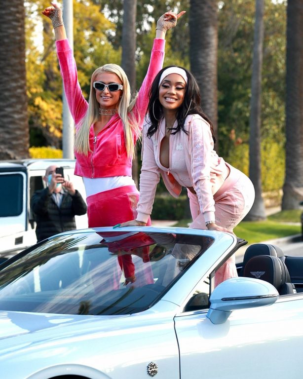 Paris Hilton and Saweetie - In Saweetie's baby blue icy girl Bentley
