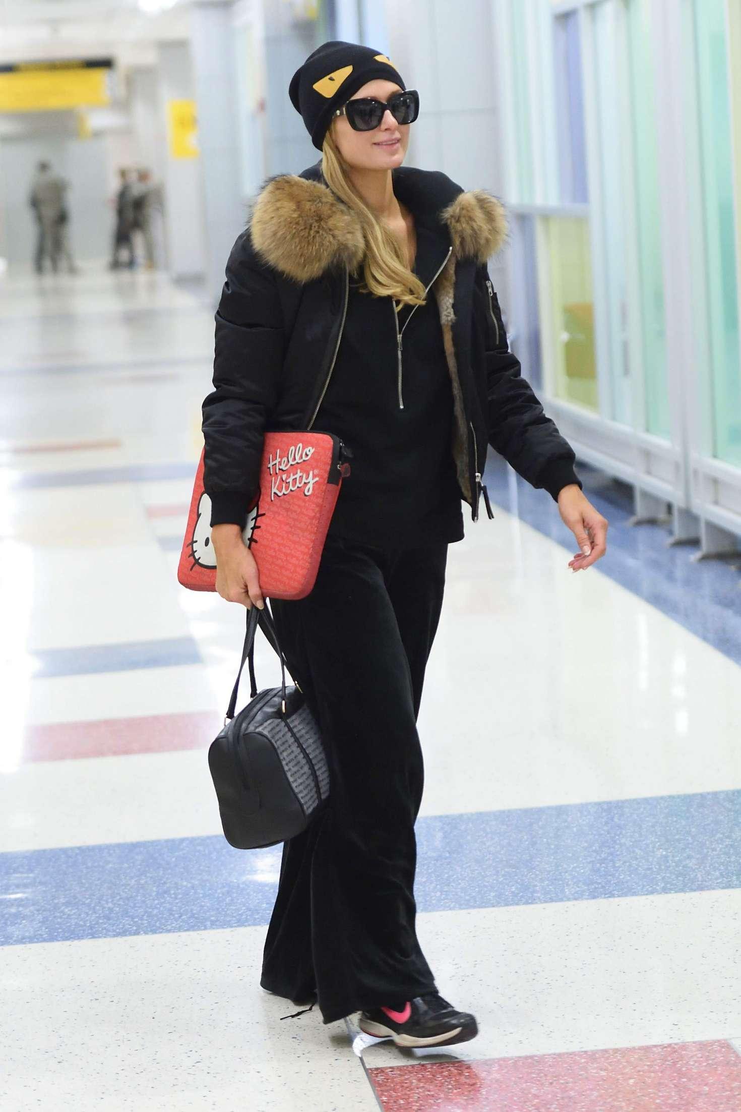 Paris Hilton - Arrives at JFK airport in New York City
