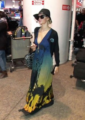 Paris Hilton in a colorful low cut dress at LAX Airport in LA