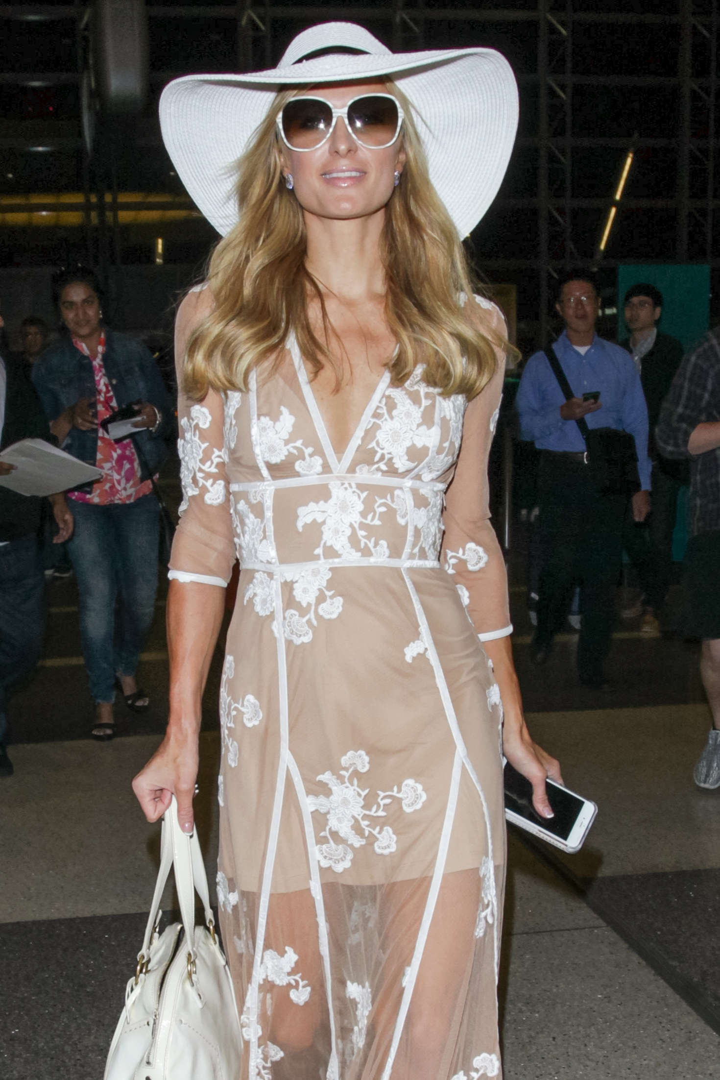 Paris Hilton in a sheer dress at Airport in Los Angeles