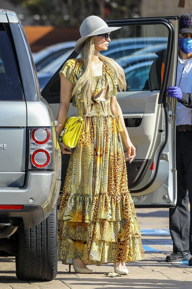 Paris Hilton -In a yellow dress out in Malibu