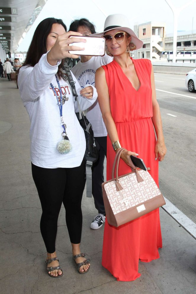 Paris Hilton in Long Dress at LAX Airport -08