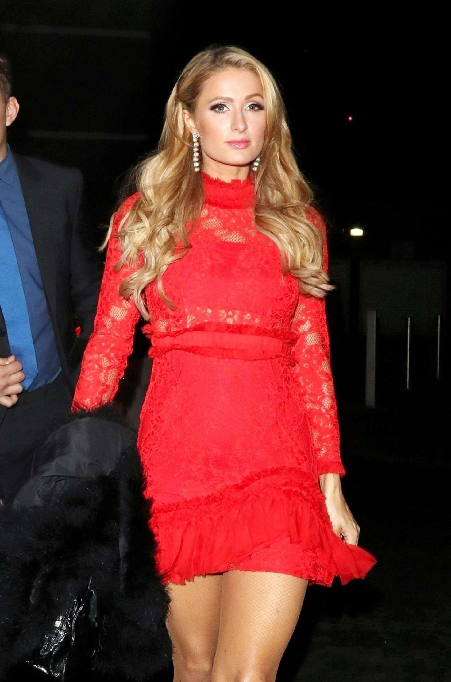 Paris Hilton In Red Mini Dress Attending House Party In