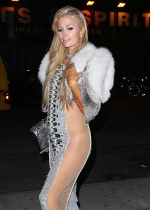 Paris Hilton in silver and sheer dress out in New York