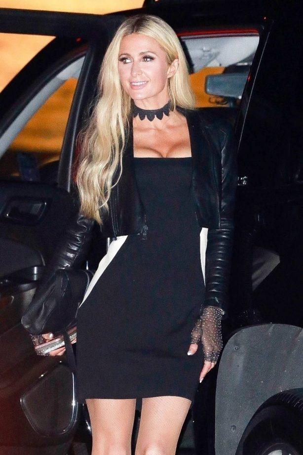 Paris Hilton - In tight black mini dress with her boyfriend Carter Reum in Malibu