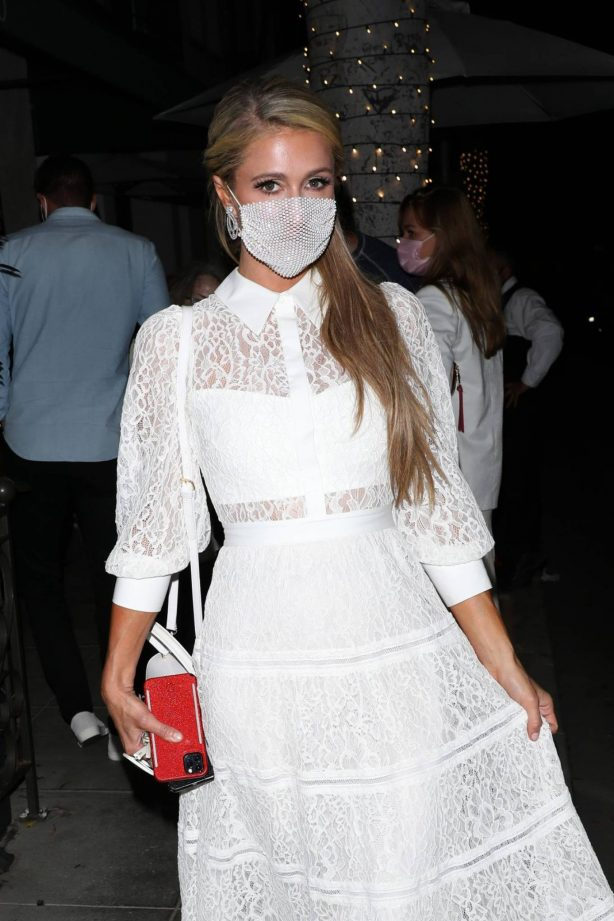 Paris Hilton in White Dress at Madeo Restaurant in Beverly Hills