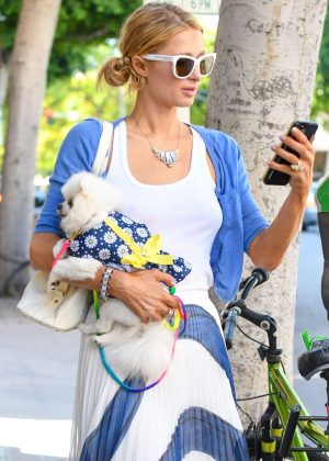 Paris Hilton with her dog out in Beverly Hills