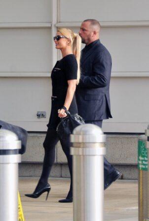 Paris Hilton - With her fiance Carter Milliken Reum Depart Washington DC.