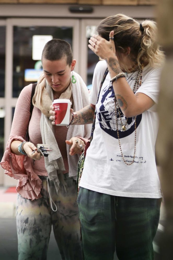 Paris Jackson at a gas station with a friend in Calabasas