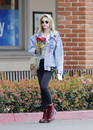 Paris Jackson buys a bouquet of red roses in Malibu