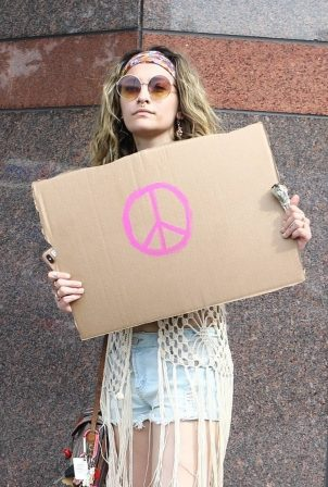 Paris Jackson - Holds a sign showing her support as she attends a protest in Los Angeles