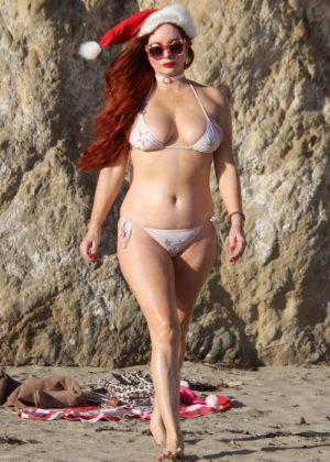 Phoebe Price in Bikini and Santa hat on the beach in Malibu