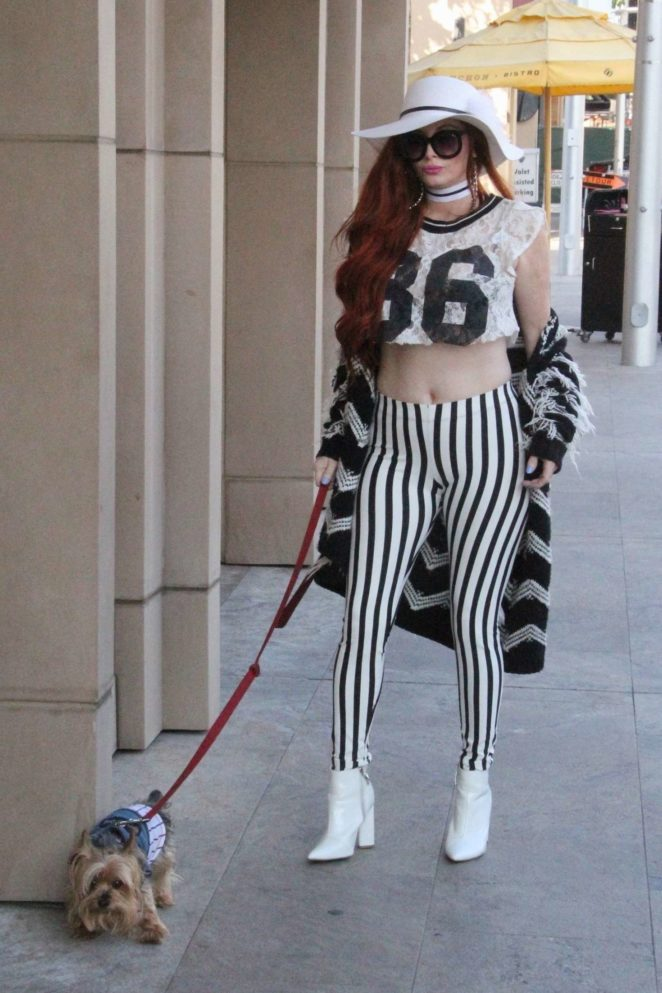 Phoebe Price out walking her dog Henry in Beverly Hills