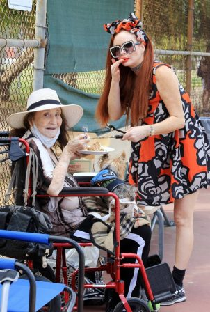 Phoebe Price - Pictured having cake with her mother in Los Angeles