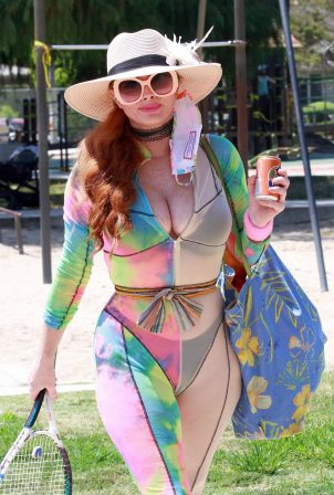 Phoebe Price - Possing while wearing tie-dye outfit