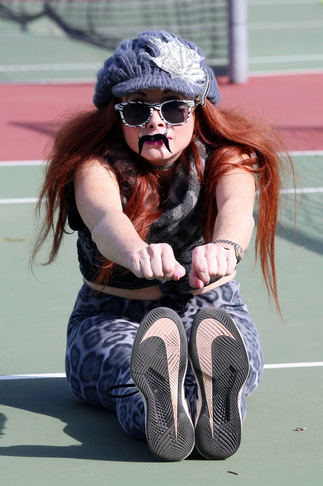 Phoebe Price - Stretchingat the tennis courts in Los Angeles